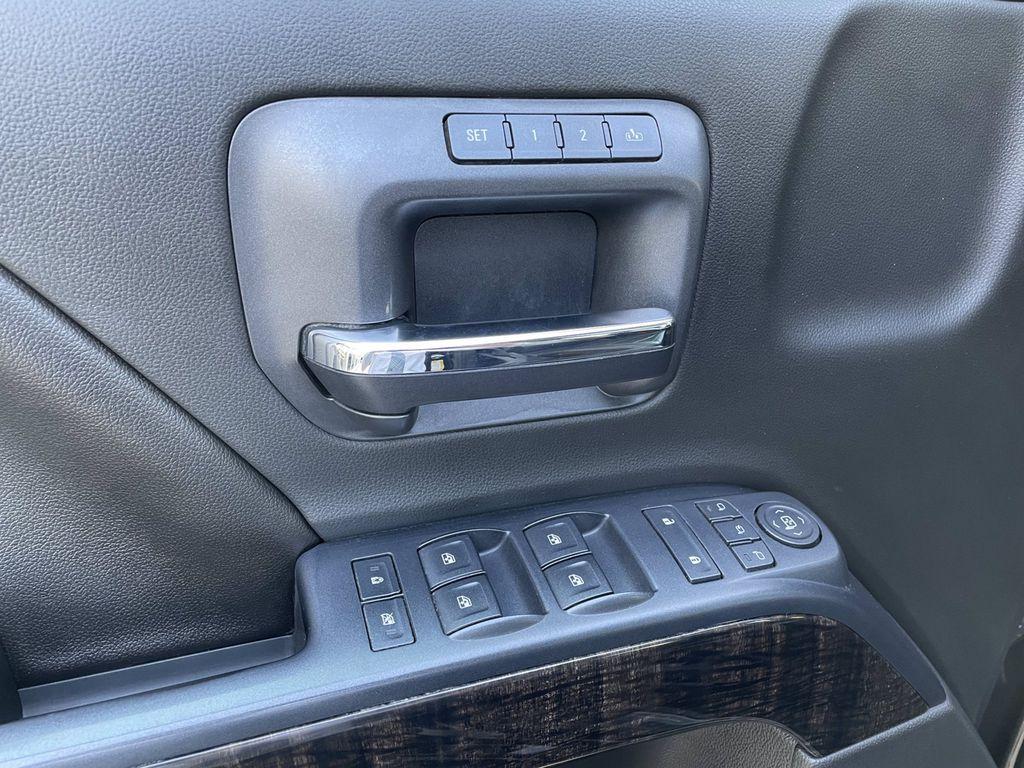Black[Onyx Black] 2016 GMC Sierra 2500HD LR Door Panel Ctls Photo in Brandon MB