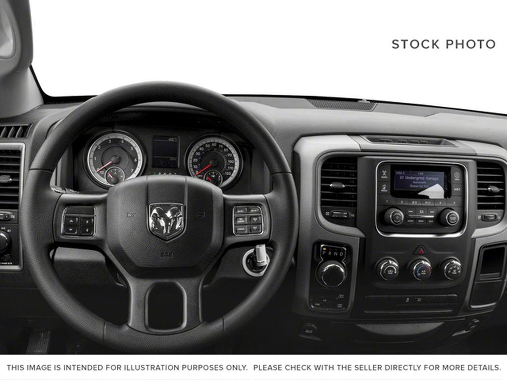 Black[Black] 2017 Ram 1500 Steering Wheel and Dash Photo in Fort Macleod AB