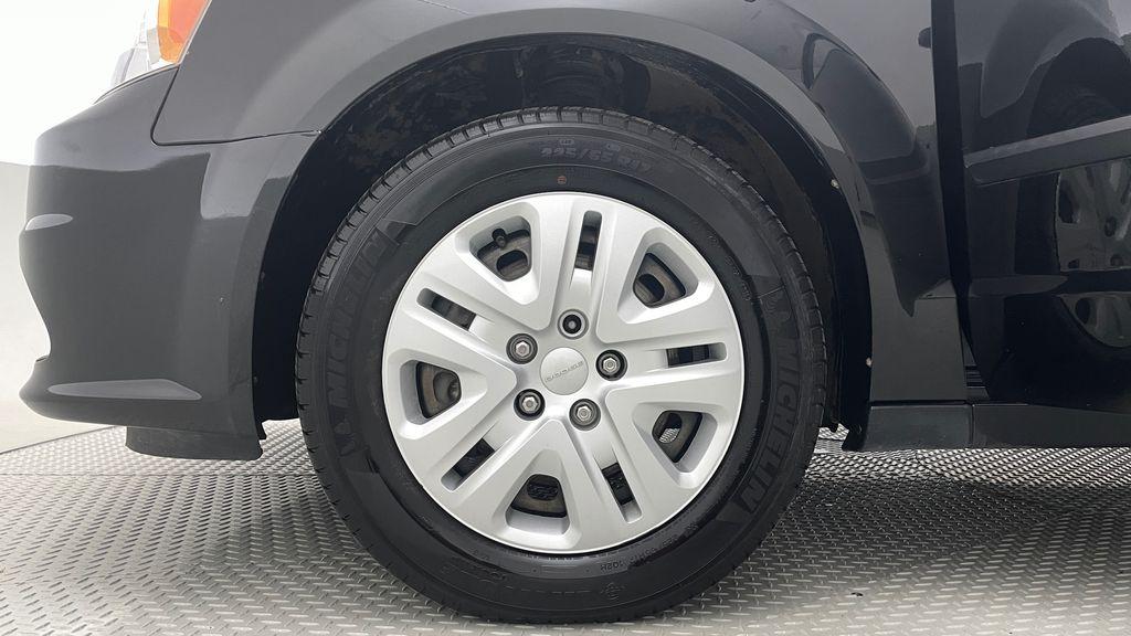 Black[Brilliant Black Crystal Pearlcoat] 2014 Dodge Grand Caravan SE - 7 Passenger, Roof Rails, LOW KMs Left Front Rim and Tire Photo in Winnipeg MB