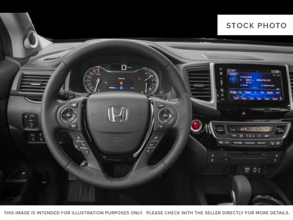 Blue[Obsidian Blue Pearl] 2019 Honda Ridgeline Steering Wheel and Dash Photo in Okotoks AB
