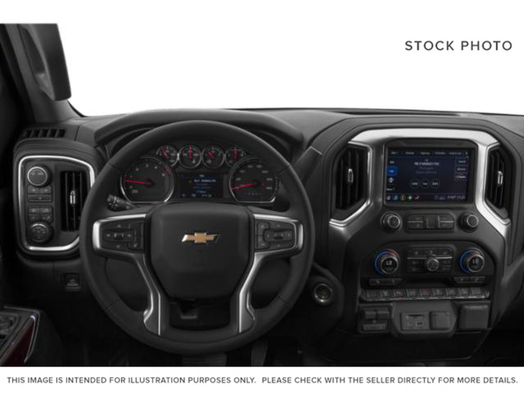White[Iridescent Pearl Tricoat] 2020 Chevrolet Silverado 3500HD Steering Wheel and Dash Photo in Fort Macleod AB