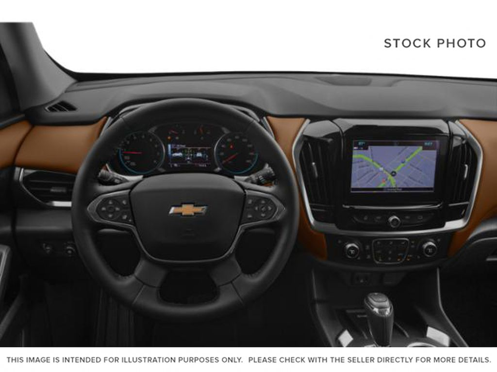 White[Iridescent Pearl Tricoat] 2018 Chevrolet Traverse Steering Wheel and Dash Photo in Fort Macleod AB