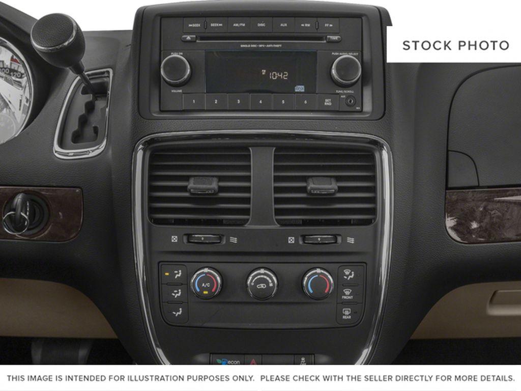 Black[Brilliant Black Crystal Pearl] 2018 Dodge Grand Caravan Radio Controls Closeup Photo in Fort Macleod AB