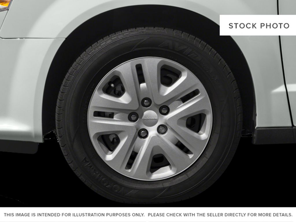 Black[Brilliant Black Crystal Pearl] 2018 Dodge Grand Caravan Left Front Rim and Tire Photo in Fort Macleod AB