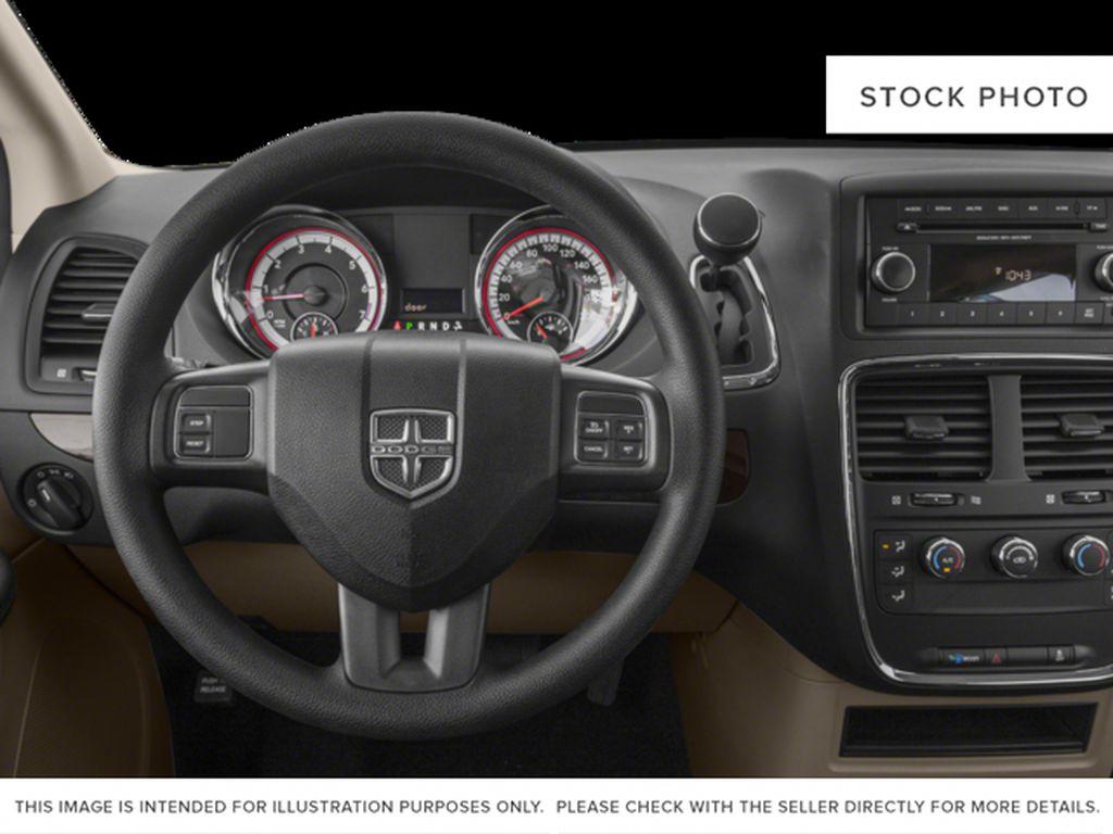 Black[Brilliant Black Crystal Pearl] 2018 Dodge Grand Caravan Steering Wheel and Dash Photo in Fort Macleod AB