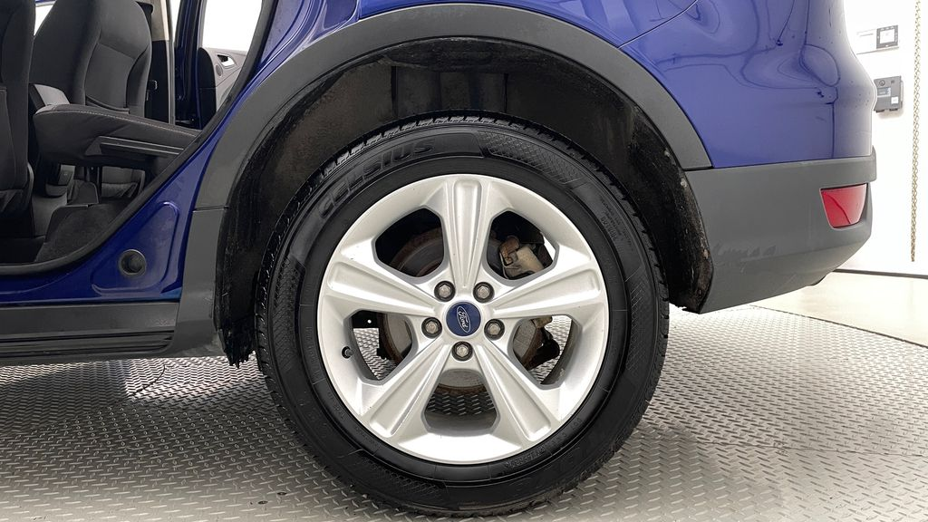 Blue[Deep Impact Blue] 2013 Ford Escape SE 4WD Left Rear Rim and Tire Photo in Winnipeg MB
