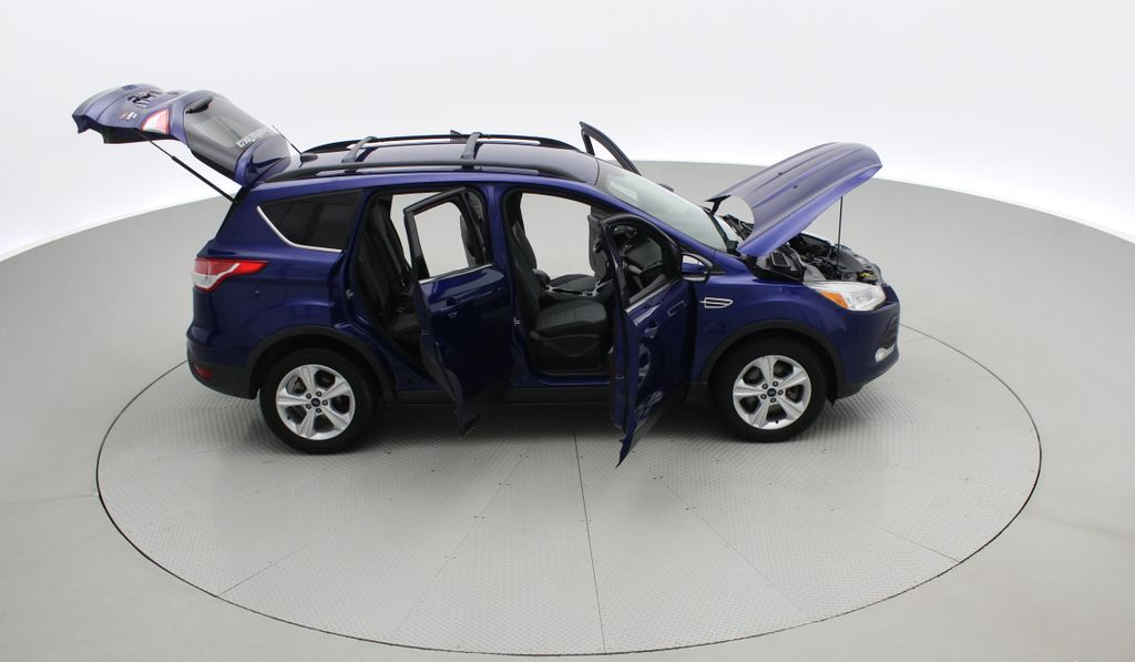 Blue[Deep Impact Blue] 2013 Ford Escape SE 4WD Right Side Photo in Winnipeg MB