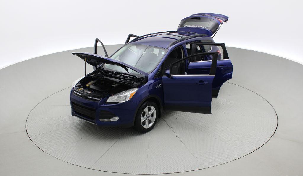 Blue[Deep Impact Blue] 2013 Ford Escape SE 4WD Left Front Corner Photo in Winnipeg MB