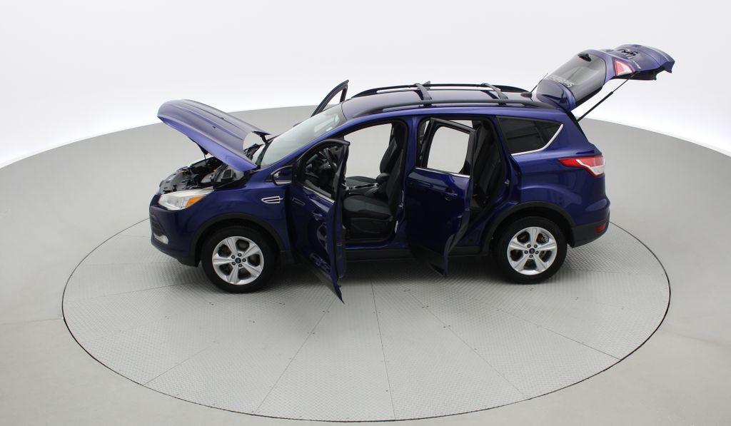 Blue[Deep Impact Blue] 2013 Ford Escape SE 4WD Left Side Photo in Winnipeg MB