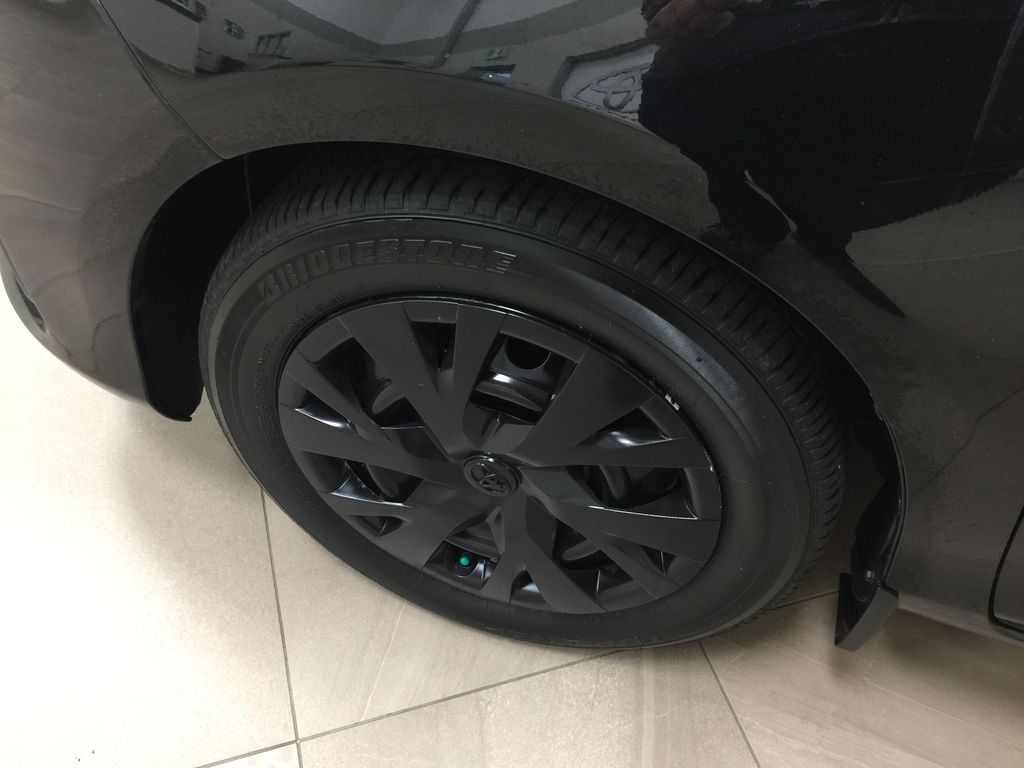 Black[Black Sand Pearl] 2019 Toyota Yaris Hatchback LE / AUTOMATIC Left Front Rim and Tire Photo in Sherwood Park AB