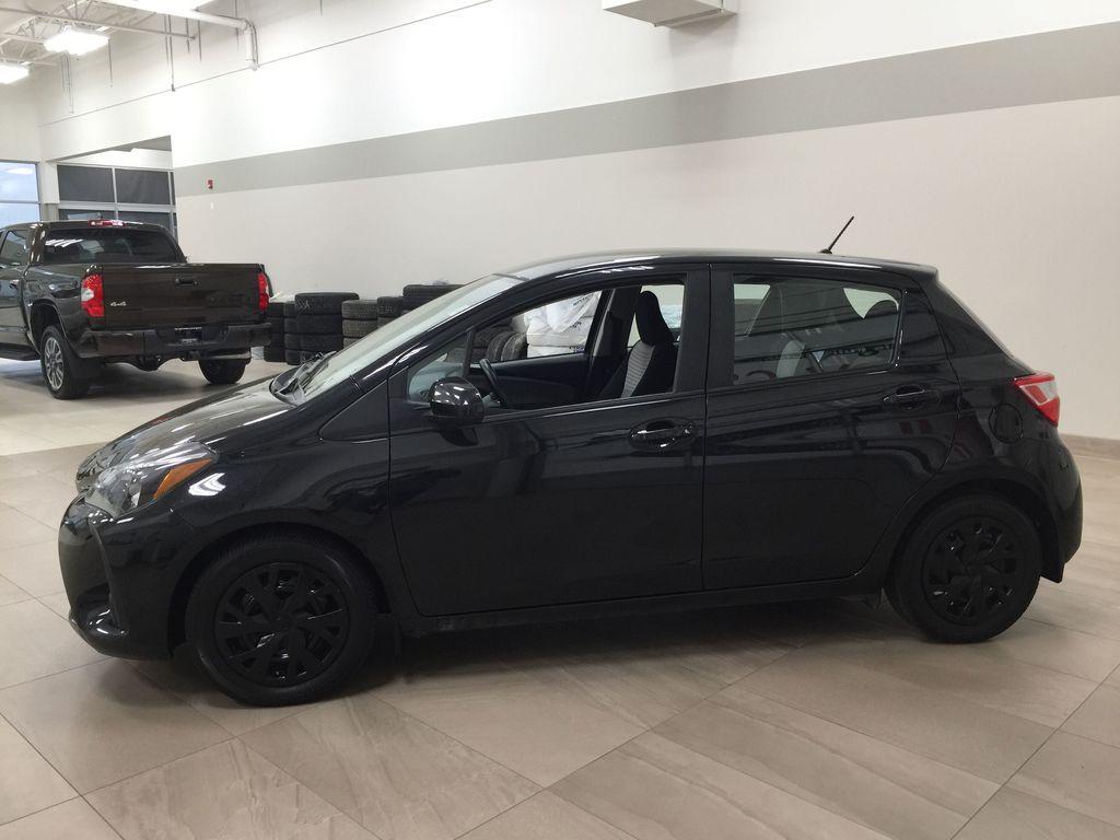 Black[Black Sand Pearl] 2019 Toyota Yaris Hatchback LE / AUTOMATIC Left Side Photo in Sherwood Park AB