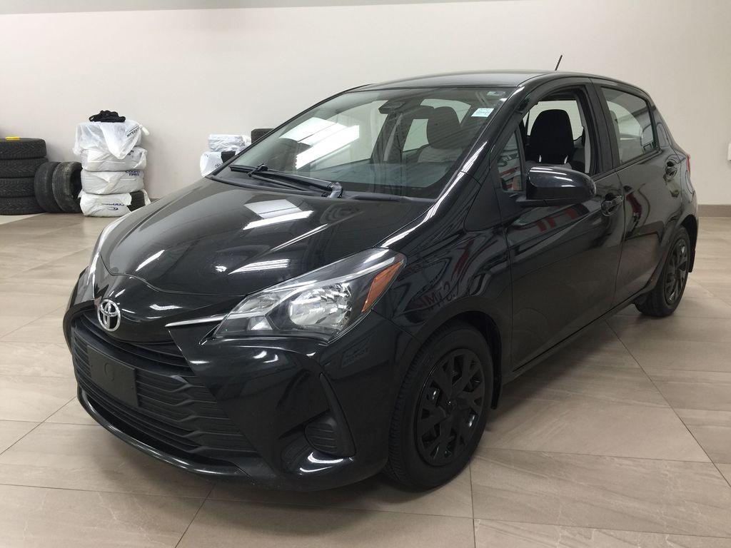 Black[Black Sand Pearl] 2019 Toyota Yaris Hatchback LE / AUTOMATIC Left Front Corner Photo in Sherwood Park AB