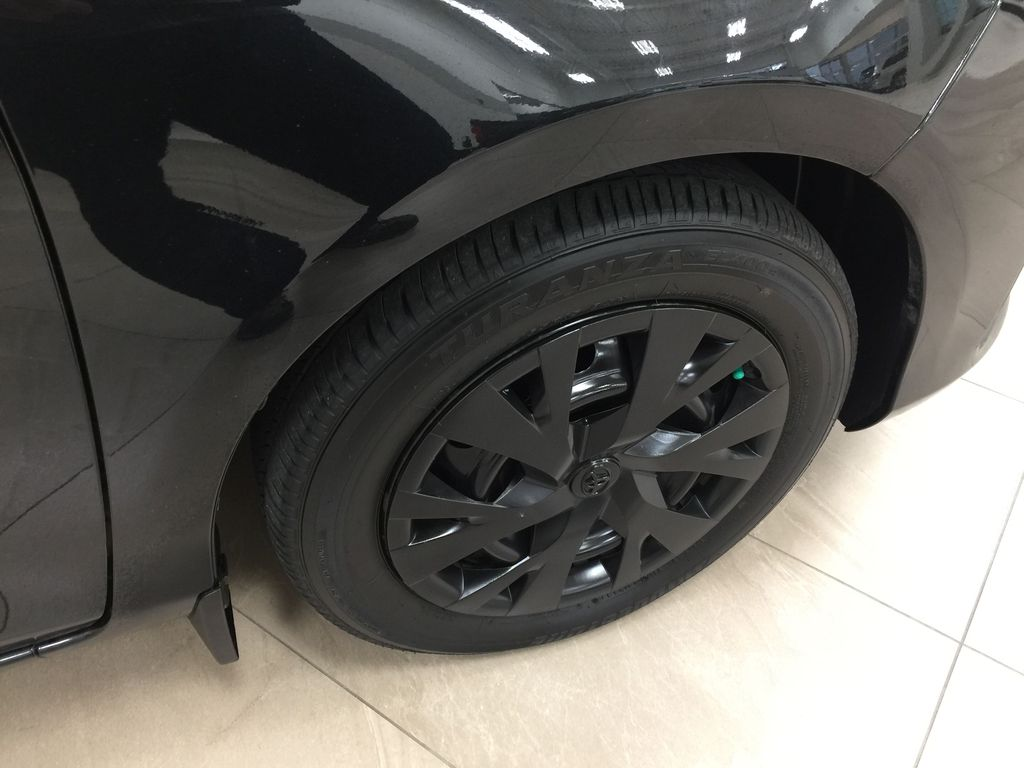 Black[Black Sand Pearl] 2019 Toyota Yaris Hatchback LE / AUTOMATIC Right Front Rim and Tire Photo in Sherwood Park AB