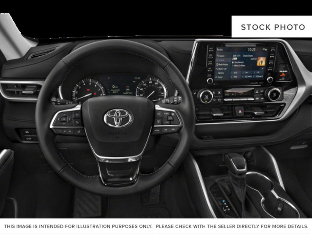 Black[Midnight Black Metallic] 2021 Toyota Highlander Steering Wheel and Dash Photo in Kelowna BC