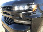 Black[Black] 2021 Chevrolet Silverado 1500 Left Front Head Light / Bumper and Grill in Edmonton AB