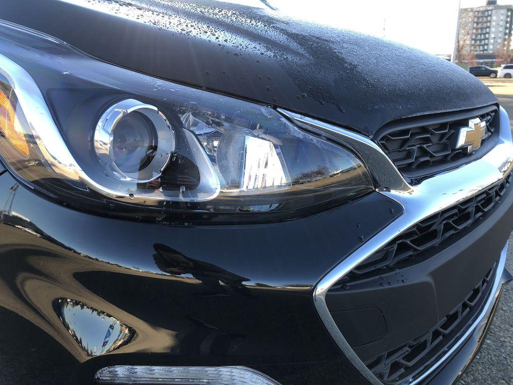 Black[Mosaic Black] 2022 Chevrolet Spark Left Front Head Light / Bumper and Grill in Edmonton AB