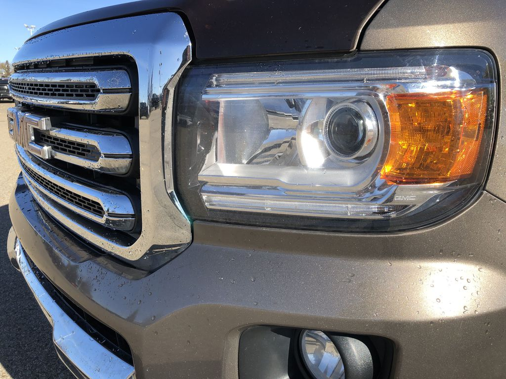 Bronze Dune Metallic 2015 GMC Canyon Left Front Head Light / Bumper and Grill in Edmonton AB