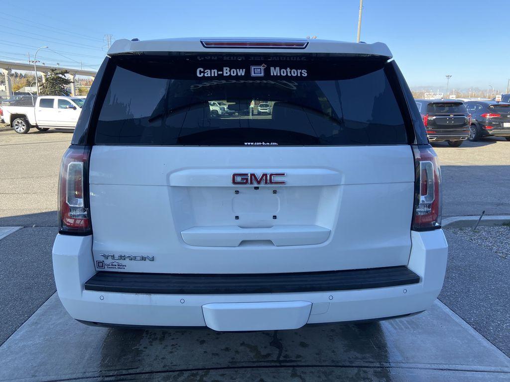 White[Summit White] 2017 GMC Yukon SLT Rear of Vehicle Photo in Calgary AB