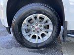 White[Summit White] 2017 GMC Yukon SLT Left Front Rim and Tire Photo in Calgary AB