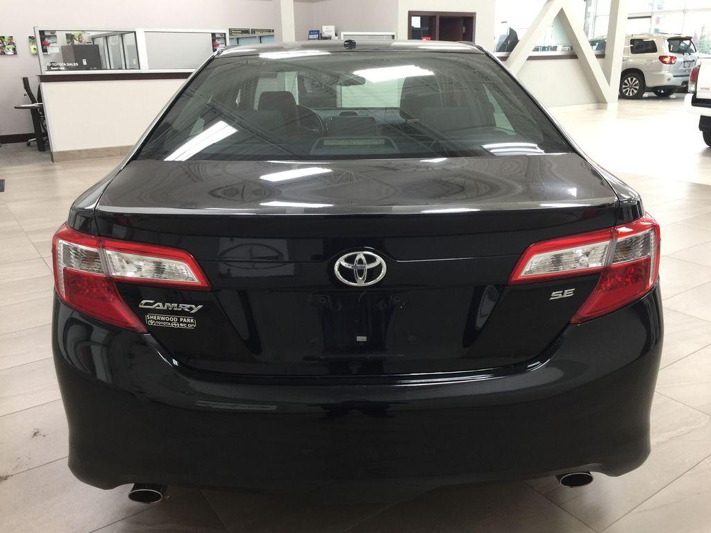 Black[Attitude Black Metallic] 2014 Toyota Camry SE V6 / LOW KMS Rear of Vehicle Photo in Sherwood Park AB