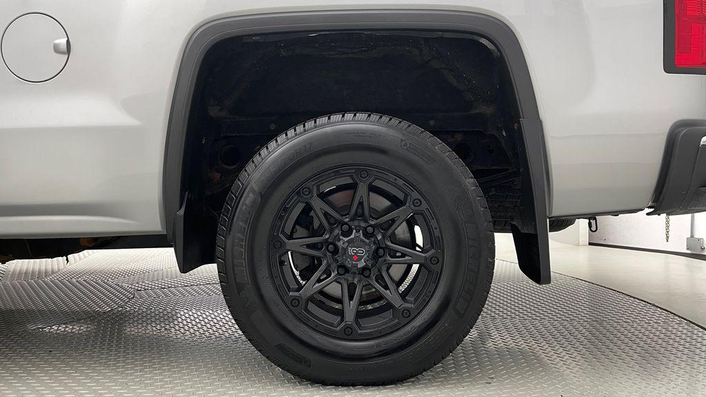 Silver[Quicksilver Metallic] 2014 GMC Sierra 1500 SLE 4WD - Double Cab, V6, Black Alloys Left Rear Rim and Tire Photo in Winnipeg MB