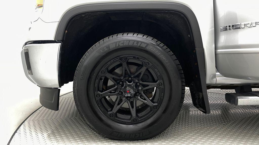 Silver[Quicksilver Metallic] 2014 GMC Sierra 1500 SLE 4WD - Double Cab, V6, Black Alloys Left Front Rim and Tire Photo in Winnipeg MB