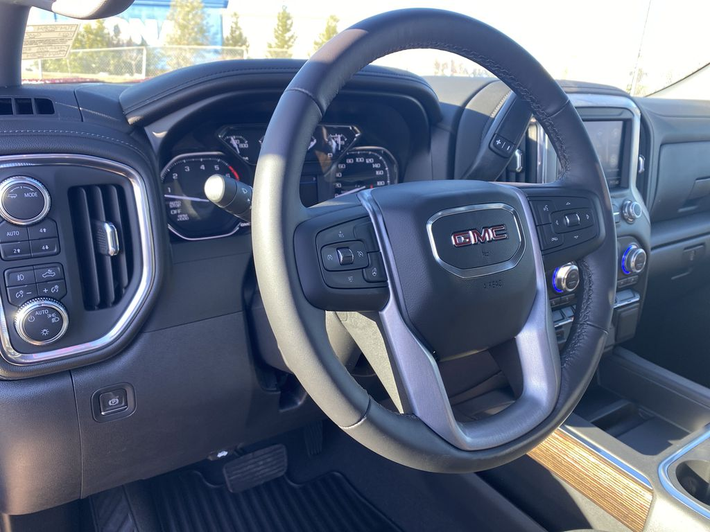 Red[Cayenne Red Tintcoat] 2021 GMC Sierra 1500 Steering Wheel and Dash Photo in Edmonton AB