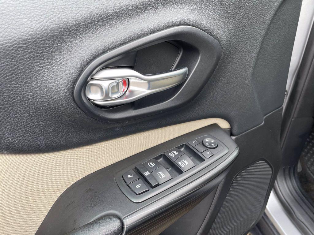 Silver[Billet Metallic] 2015 Jeep Cherokee Left Rear Interior Door Panel Photo in Brandon MB