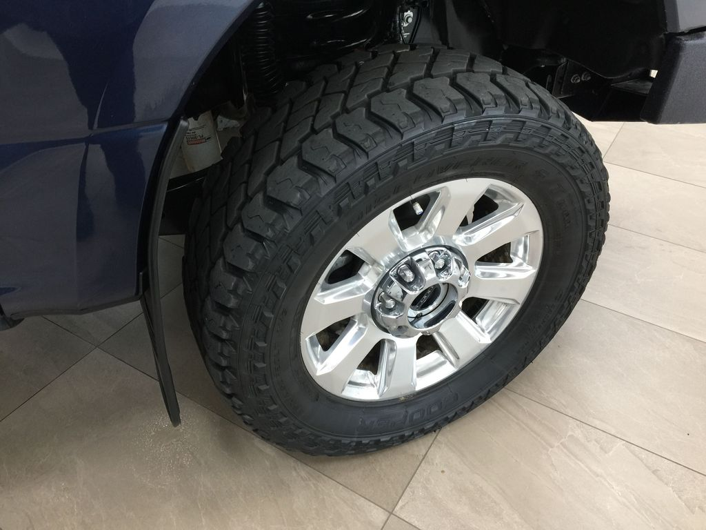 Blue 2020 Ford F-350 Crew Cab / PLATINUM / CREWCAB / 5TH WHEEL PREP PACK Right Front Rim and Tire Photo in Sherwood Park AB