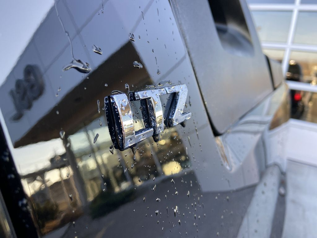 Black[Black] 2010 Chevrolet Avalanche LTZ Strng Wheel: Frm Rear in Calgary AB