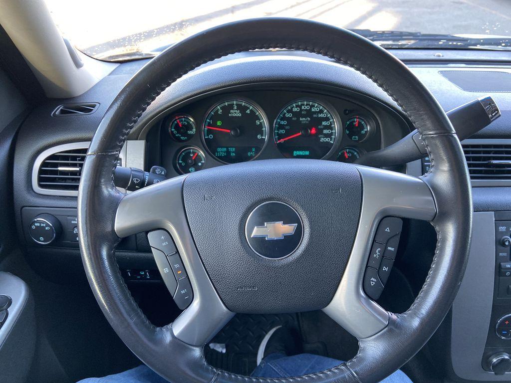 Black[Black] 2010 Chevrolet Avalanche LTZ Steering Wheel and Dash Photo in Calgary AB