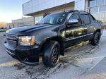 Black[Black] 2010 Chevrolet Avalanche LTZ Left Front Head Light / Bumper and Grill in Calgary AB
