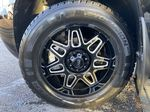 Black[Black] 2010 Chevrolet Avalanche LTZ Left Front Rim and Tire Photo in Calgary AB