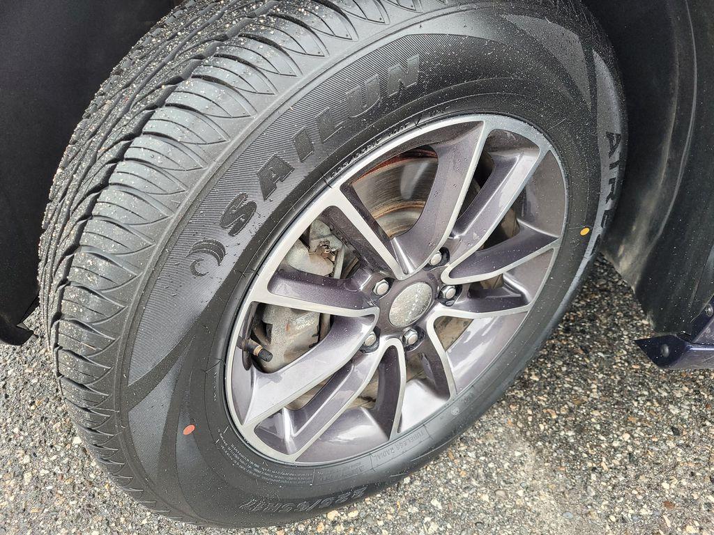 Blue[Jazz Blue Pearl] 2017 Dodge Grand Caravan Left Front Rim and Tire Photo in Kelowna BC