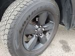 Black[Brilliant Black Crystal Pearl] 2018 Dodge Ram 1500 Bighorn 4WD Left Front Rim and Tire Photo in Kelowna BC