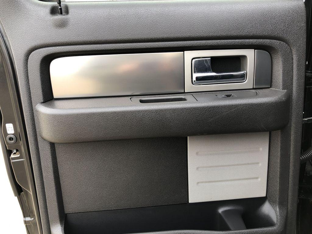 Black[Tuxedo Black Metallic] 2014 Ford F-150 Left Rear Interior Door Panel Photo in Edmonton AB