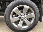 Black[Tuxedo Black Metallic] 2014 Ford F-150 Left Front Rim and Tire Photo in Edmonton AB