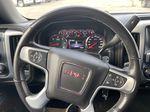 White[Summit White] 2016 GMC Sierra 1500 SLE Steering Wheel and Dash Photo in Calgary AB