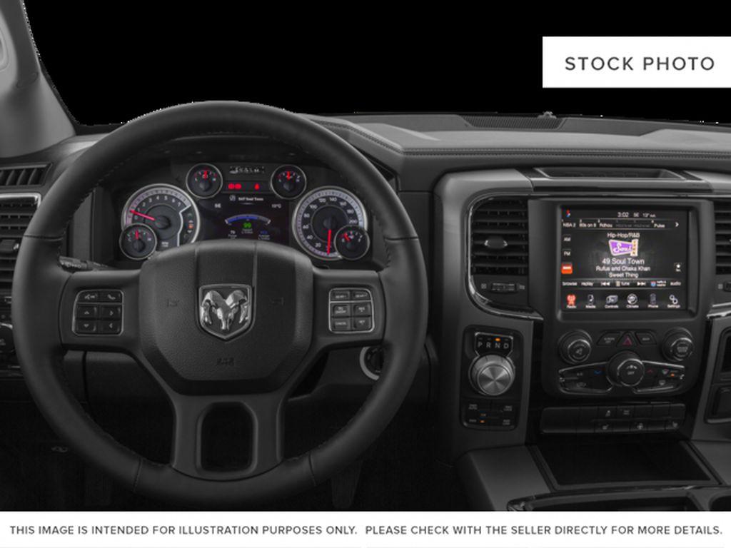 Blue[Blue Streak Pearl] 2015 Ram 1500 Steering Wheel and Dash Photo in Fort Macleod AB