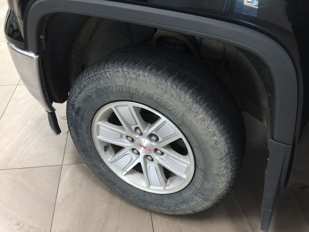 Black[Onyx Black] 2014 GMC Sierra 1500 SLE Left Front Rim and Tire Photo in Sherwood Park AB