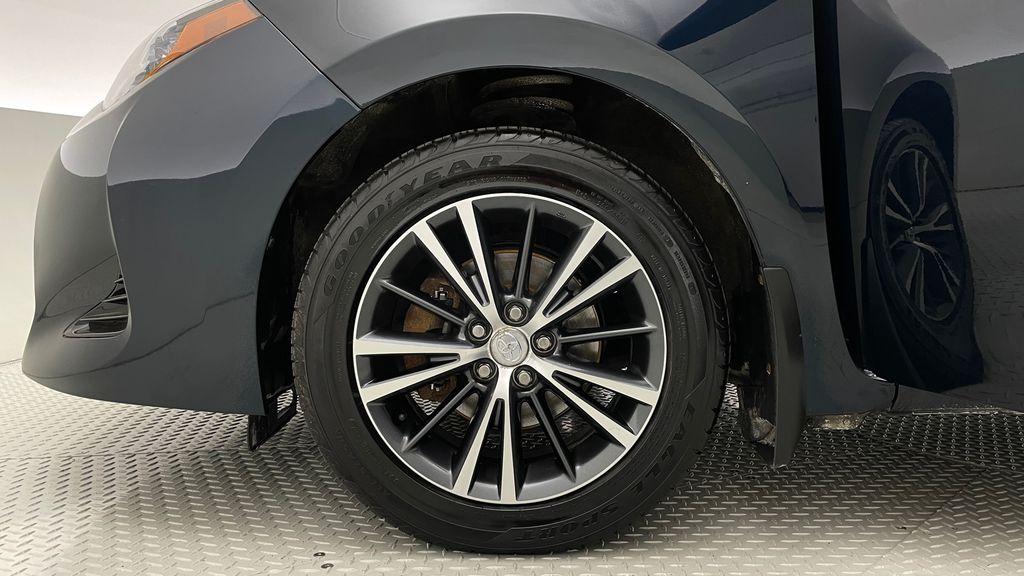 Blue[Galactic Aqua Mica] 2018 Toyota Corolla LE - Corolla Upgrade Package w/ Sunroof, Alloys Left Front Rim and Tire Photo in Winnipeg MB