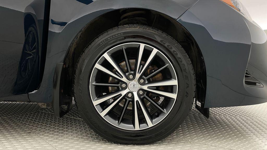 Blue[Galactic Aqua Mica] 2018 Toyota Corolla LE - Corolla Upgrade Package w/ Sunroof, Alloys Right Front Rim and Tire Photo in Winnipeg MB