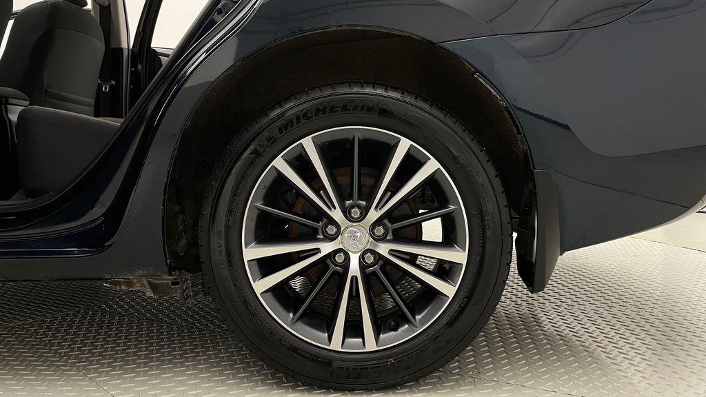 Blue[Galactic Aqua Mica] 2018 Toyota Corolla LE - Corolla Upgrade Package w/ Sunroof, Alloys Left Rear Rim and Tire Photo in Winnipeg MB