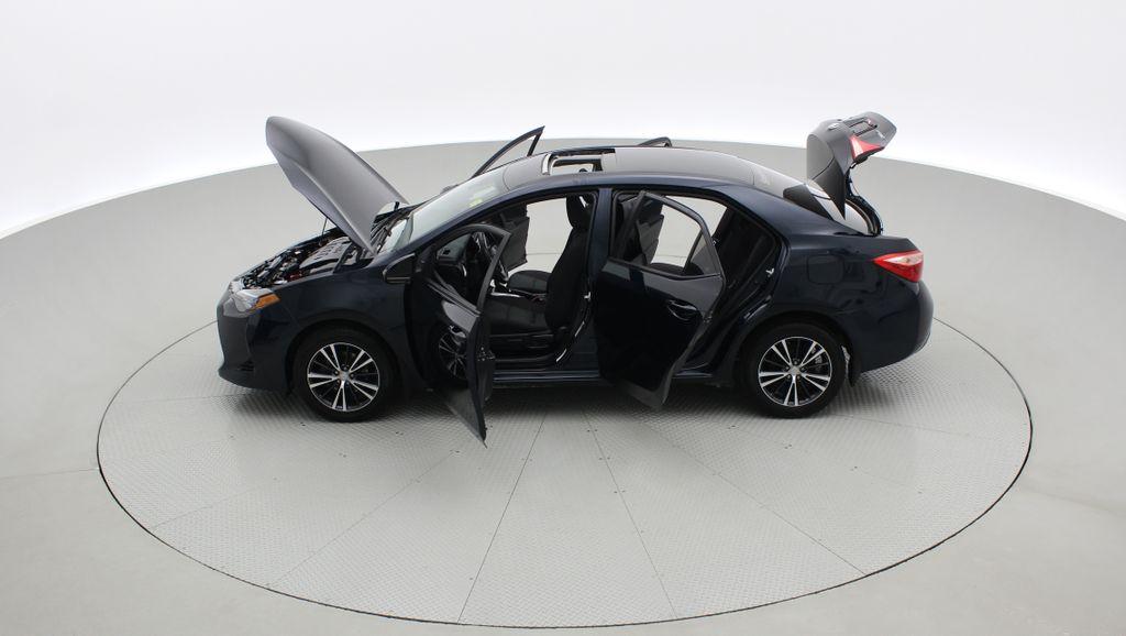 Blue[Galactic Aqua Mica] 2018 Toyota Corolla LE - Corolla Upgrade Package w/ Sunroof, Alloys Left Side Photo in Winnipeg MB