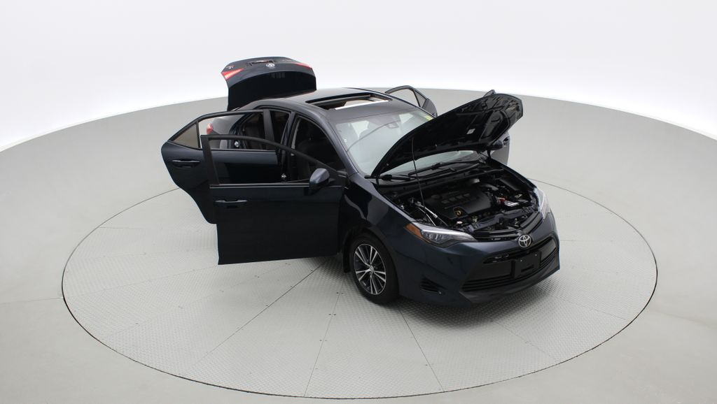 Blue[Galactic Aqua Mica] 2018 Toyota Corolla LE - Corolla Upgrade Package w/ Sunroof, Alloys Left Front Corner Photo in Winnipeg MB