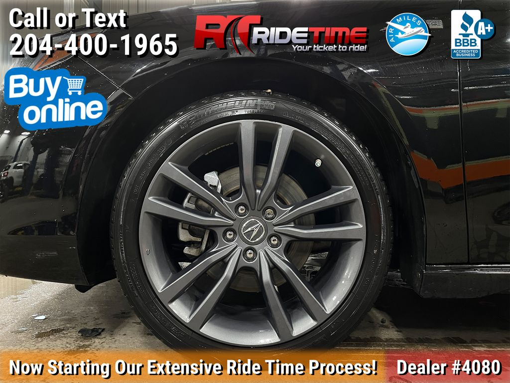 Black[Crystal Black Pearl] 2019 Acura TLX Tech A-Spec SH-AWD Left Front Rim and Tire Photo in Winnipeg MB