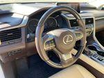White[Eminent White Pearl] 2017 Lexus RX 350 Steering Wheel and Dash Photo in Edmonton AB