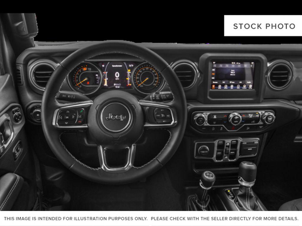 Black[Black] 2021 Jeep Wrangler Steering Wheel and Dash Photo in Fort Macleod AB