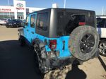 Blue[Chief Clearcoat] 2017 Jeep Wrangler Unlimited 4X4 Left Rear Corner Photo in Sherwood Park AB