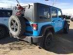 Blue[Chief Clearcoat] 2017 Jeep Wrangler Unlimited 4X4 Rear of Vehicle Photo in Sherwood Park AB